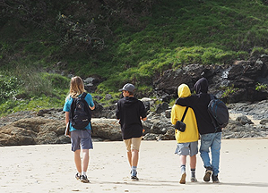 Image of students walking on the beach for Walk & Talk
